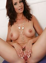 Curvy aged milf Wendy gets her cunt wet within the shower.