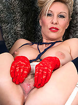 Pussy Pics: Saffy teases over the phone, then turned on by her kinky girdle and seamed nylon hose, opens up and cums for us.