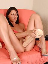 Lexi stuffs her snatch with a giant brutal dildo