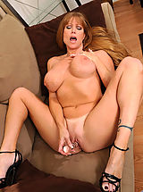 Darla Crane, Seductive brunette Darla Crane plunges a glass dildo deep inside of her cougar fuck hole