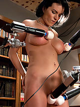 Girl spread and pinned down by four vibrators while the machines fuck orgasm after orgasm out of her pussy and ass.