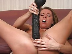 Stretching Her Hole With A Black Brutal Dildo