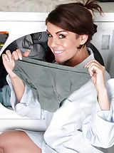 Horny housewife slips off her husbands work shirt in the laundry room