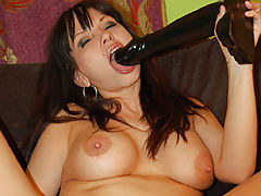 Carrie Ann stuffing a brutal dildo in her snatch
