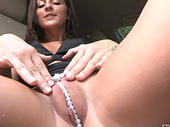 Melissa sits in a car with a sweet camel toe with pearls
